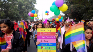 LGBTQ rights activists and their supporters hold colorful balloons and placards as they participate in a Pride march in New Delhi Nov. 12, 2017. (AP)
