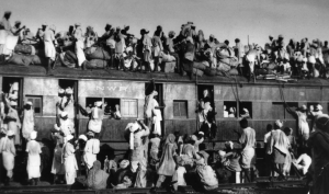 Muslim refugees clamber aboard an overcrowded train near New Delhi in an attempt to flee India, Sept. 1947. (Associated Press)